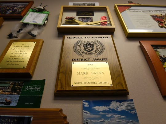Boys & Girls Clubs Director Mark Sakry's office walls are covered with awards and photos collected in his 38 years experience with the organization.