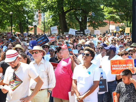 Hundreds gather at the Families Belong Together March at Washington Park in Over-The-Rhine, on June 30, 2018. The march was one of several taking place around the United States to protest Donald Trump's immigration policy.
