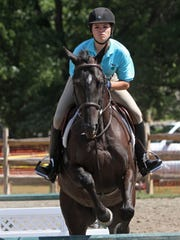 Samantha Eristavi competes in a jumping event at the