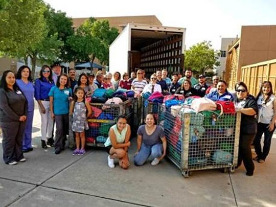 Memorial employees work together to donate 396 backpacks to Las Cruces Public Schools students in need.
