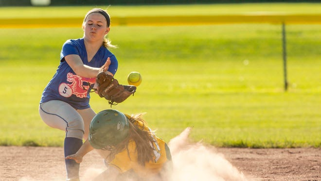 Colchester's Megan Hoague bobbles the ball at second as BFA's Kaylee O'Brien slides into the base. Fourth seeded BFA St. Albans hosted fifth Colchester Friday in the quarterfinal found of the D1 softball playoffs.