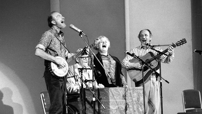 In this Nov. 28, 1980, file photo, The Weavers perform in a 25th Anniversary reunion concert at Carnegie Hall in New York. From left are: Pete Seeger, Lee Hays, Ronnie Gilbert and Fred Hellerman.