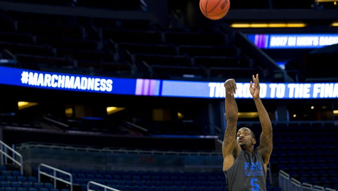 Florida Gulf Coast University sophomore Zach Johnson practices Wednesday at the Amway Center in Orlando. The Eagles face FSU in the first round of the NCAA tournament.
