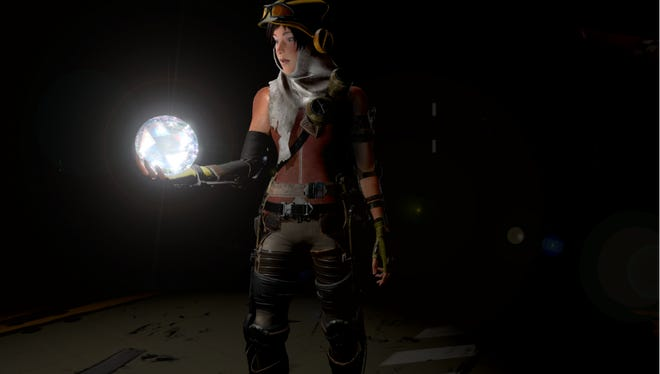 Lead character Joule holds an energy core in a scene from 'ReCore.'
