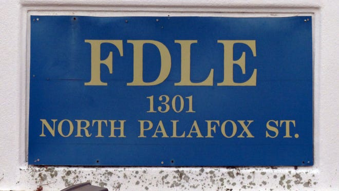 Sign in front of the Florida Department of Law Enforcement building located on 1301 N. Palafox Street.