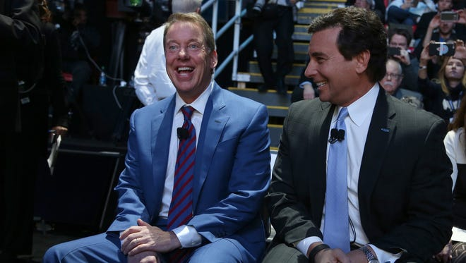 Bill Ford, the executive chairman of Ford Motor Company and Mark Fields, president and CEO of Ford laugh while having their picture taken by photographers at the 2016 North American International Auto Show.