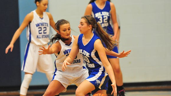 Pisgah's Brooklyn Allen defends Owen's Taylor Lovci during Saturday's Blue-White All-Star girls basketball game at Enka.
