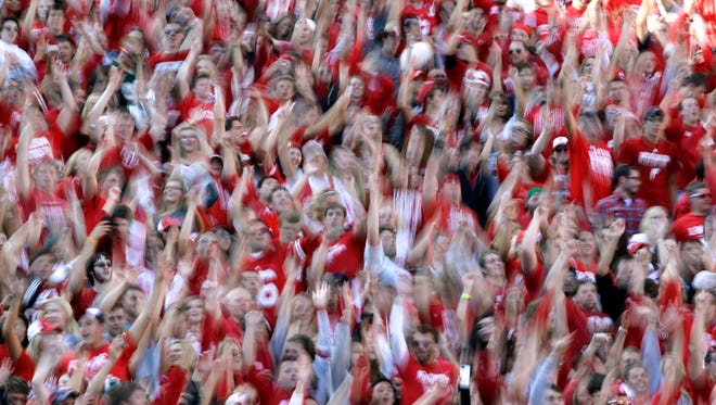 """Wisconsin students dance and """"Jump Around"""" to House of Pain's 1992 hit during a recent football game."""