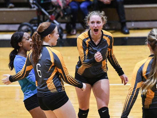 Crescent sophomore Mackenzie Hayes(11), right, and