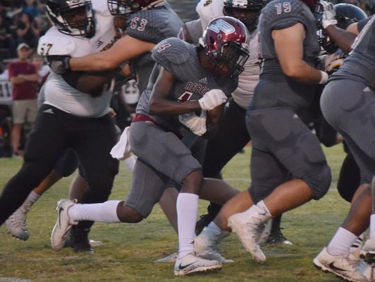 Pineville's Cameron Blackwell (14) tries to get through