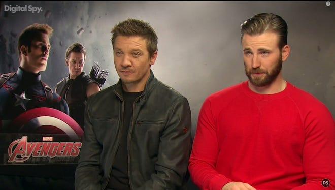 A screenshot of Jeremy Renner and Chris Evans from the Digital Spy interview.