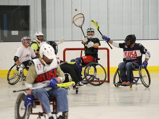 Matt Esmay throws a pass from the goal during a wheelchair lacrosse scrimmage Sunday at the Scheels IcePlex. The scrimmage was part of a clinic teaching the basics of the sport and was sponsored by Wheelchair Lacrosse USA, Sanford Health and the Sioux Falls VA Health Care System.