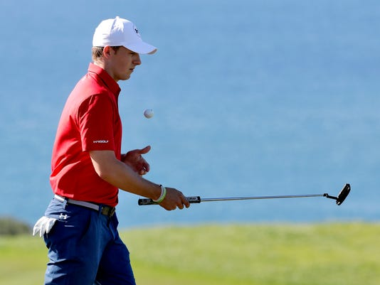 Jordan Spieth picks up his ball on the 10th green during the pro-am tournament prior to the Tournament of Champions golf event, Wednesday, Jan. 4, 2017, at Kapalua Plantation Course in Kapalua, Hawaii. (AP Photo/Matt York)