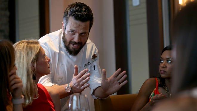Fabio Viviani talks to diners at his eponymous Portico by  Fabio Viviani at del Lago Resort & Casino.