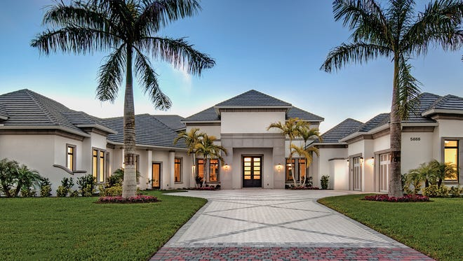 Interior design by Clive Daniel Home is featured in Fox Custom Homes' Bellissima model at Quail West..