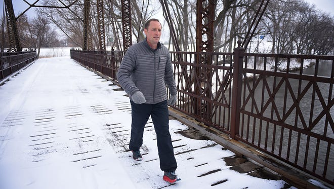 Lance Smith walks on the bridge by Yankton Trail Park at 57th and Wester Avenue Monday, April, 9, in Sioux Falls. Smith is walking 72 miles in 24 hours to raise money for a mission trip to Kenya for Good News Church. He says he has walked roughly 800 miles since October. Smith was inspired to start walking for the mission trip with he was in church one day and the teaching was about being selfless in God.