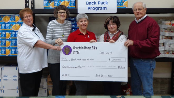 The Mountain Home Elks Lodge 1714 recently donated $1,000 to the local Backpack Food 4 Kids program. The program provides Mountain Home school children with weekend meals to help alleviate hunger. Shown are Cathy Schweer, Elks president, from left; Kathy Bauer, Jo Strickland, Linda DeMass, co-directors of the Backpack program; and Butch Holligan, Elks grant coordinator.
