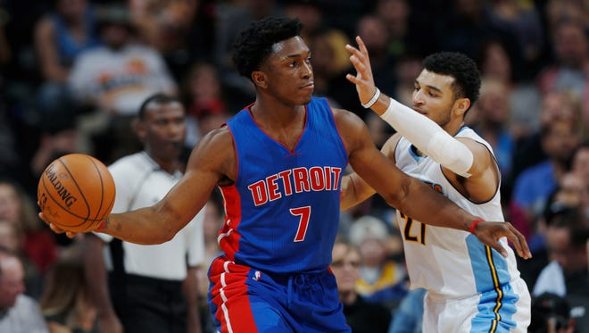 Pistons forward Stanley Johnson looks to pass as Nuggets guard Jamal Murray defends in the second half of the Pistons' 106-95 win over the Nuggets on Nov. 12, 2016 in Denver.