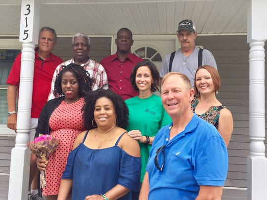 This Saturday, July 1, 2017 photo shows Esau Occeas (top row, second from left) and his daughter, Veronica,(second row left) in front of the home they purchased from Habitat for Humanity of Wicomico County. The house was dedicated Saturday at a ceremony attended by supporters including Molly Hilligoss (second row far right), Salisbury City Councilwoman April Jackson (front row left) and Mac Bellamy (front row right). The house was donated to Habitat by Earl Herweck of Ocean Pines (top row far left).