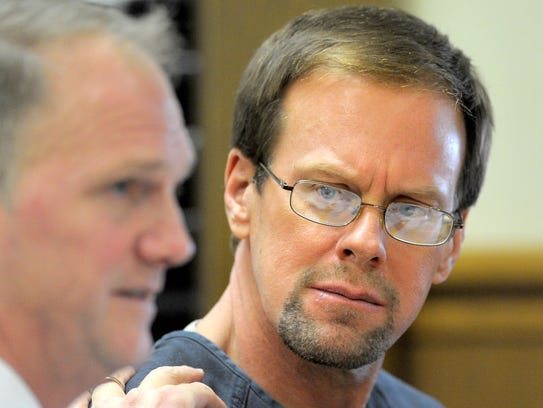 Mark Jensen looks at his attorney, Craig Albee, during