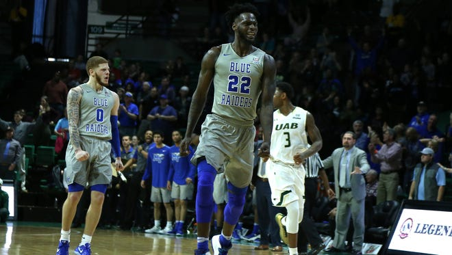 MTSU forward JaCorey Williams (22) reacts after hitting the game-winning shot at UAB on Sunday.