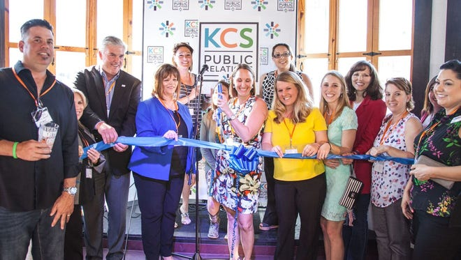 KCS Public Relations staff celebrate the new brand name with a ribbon cutting on Wednesday May 24, 2017.