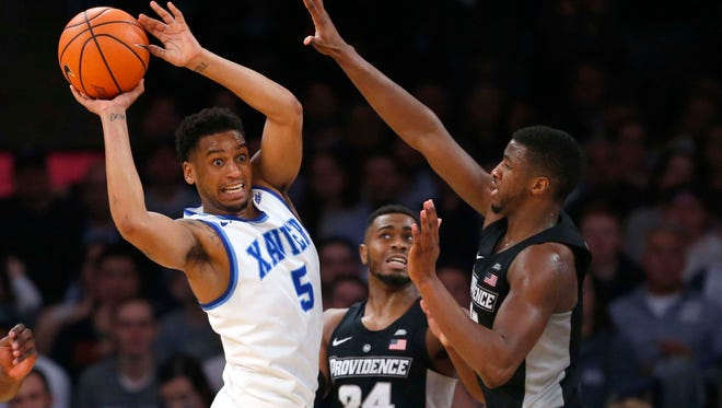 Providence Friars guard Alpha Diallo (11) and guard Kyron Cartwright (24) defend against Xavier Musketeers guard Trevon Bluiett (5) during overtime of Big East Conference Tournament semifinals game at Madison Square Garden on March 9, 218.