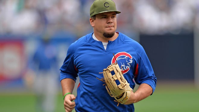 Chicago Cubs left fielder Kyle Schwarber (12) jogs in from the outfield before the game against the San Diego Padres at Petco Park on May 29.