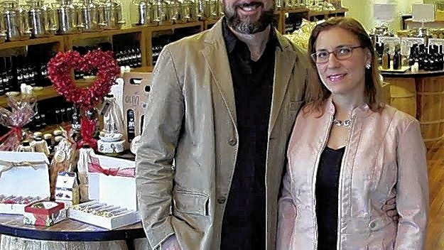 Olivina Taproom owners Chris and Catherine Schobert are the first beneficiaries of a Delaware grant program designed to help small businesses affected by the COVID-19 coronavirus shutdown and the May 19 flooding.