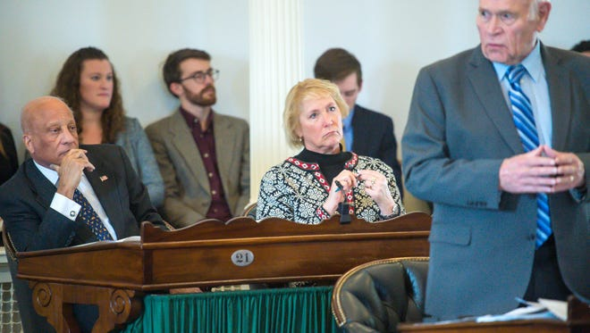 Sen. Carolyn Branagan, center, and Sen. Randy Brock, Republicans from Franklin County, listen as Senator Dick Sears, D-Bennington, explains a bill at the Statehouse in Montpelier in January.