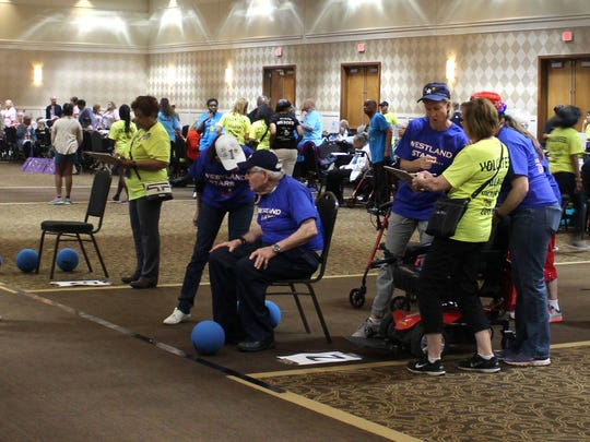 Senior citizens compete in the kick-a-roo event at the Village Victory Cup on Friday, June 22, 2018.