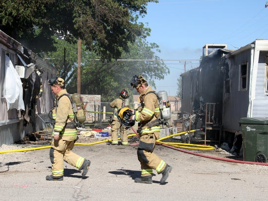 One flaming mobile home's radiant heat caught a neighboring