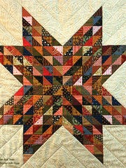 Quilt squares, this one from Ye Old Schoolhouse Quilt Stop in Cedarburg, sometimes are about much more than stitches and patterns.