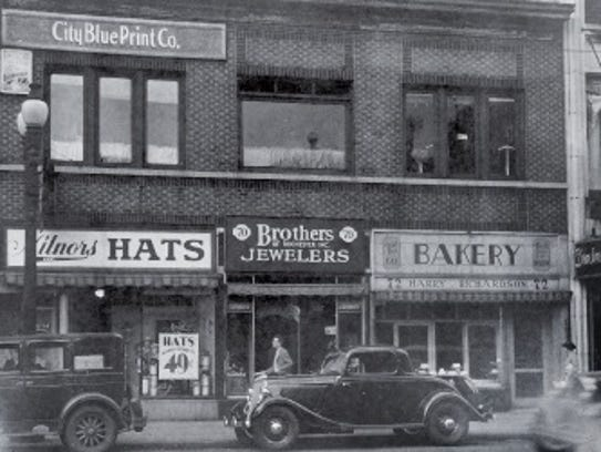 City Blue Print Co.'s sign is on the second level store