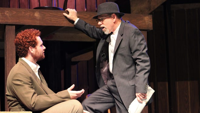 """Bassanio (Griffin Jones, left) and Shylock (Adam Hester) talk about making a financial arrangment in this rehearsal scene from """"The Merchant of Venice."""""""