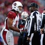Larry Fitzgerald of the Arizona Cardinals speaks with the officials after a call during their NFL game against the San Francisco 49ers at Levi's Stadium on November 29, 2015 in Santa Clara, California.