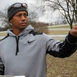 Tiger Woods looks over the site at Thompson's Station where he is expected to design a golf course.