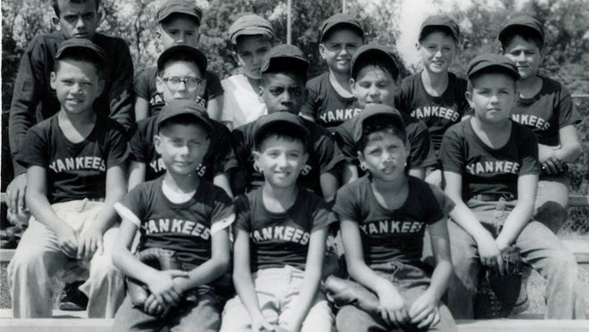 It shows the Yankees of the Poughkeepsie Minor league in August 1957.