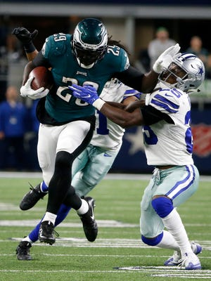 Philadelphia Eagles running back LeGarrette Blount breaks a tackle attempt by Dallas Cowboys' Xavier Woods in the second half Nov. 19, 2017 in Arlington, Texas.