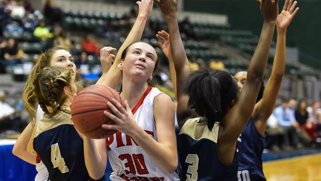 Pine Grove's Haley Vick (30) shoots against a host of Bogue Chitto defenders the team's 1A quarterfinals game Thursday at Mississippi Coliseum. Pine Grove won, advancing to the semfinals.