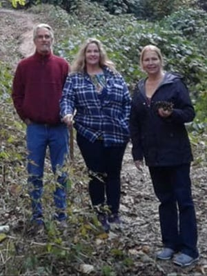 Andrew Williams, Marie Williams, and Charmain Barbel, left to right, vacationed in Sky Valley, Georgia, before a car crash on the drive home sent them all to the hospital.