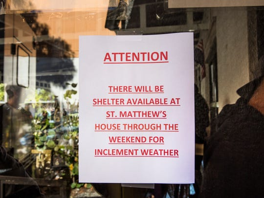 A sign advertising shelter availability hangs on the door during lunch at Justin's Place Feeding Ministry in East Naples on Thursday, Jan. 4, 2018. When there is severe weather, St. Matthew's House provides additional beds at their shelters in Naples and Immokalee.