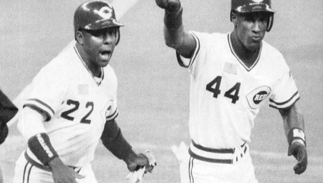 The Reds' Eric Davis (44) celebrates with teammate Billy Hatcher after hitting a two-run homer against the Oakland Athletics in Game 1 of the World Series on Oct. 16, 1990.