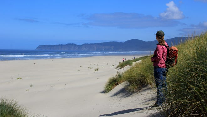 Katie Duzik, natural resources specialist for the coastal region of Oregon?s state parks, looks out on the one mile of beach that's part of the Beltz Property, a 357-acre parcel north of Pacific City that will become Oregon's next state park. In the distance is Cape Lookout.