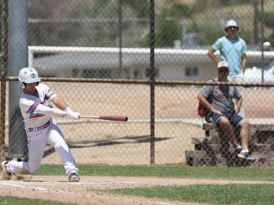 D-BAT Elite's Ty Coleman hits a home run in the top of the sixth inning against the South Troy Dodgers on Sunday at Worley Field.