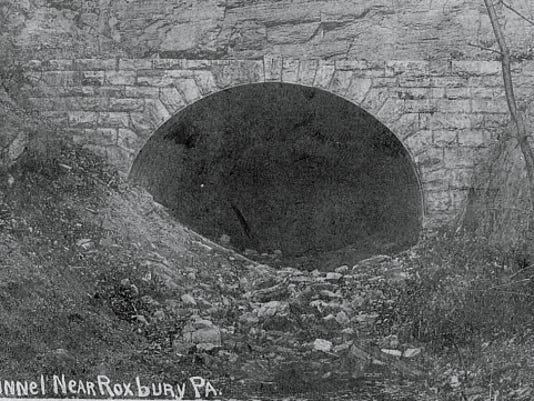 This photograph of the unfinished Blue Mountain railroad tunnel was taken in the early 1900s. It became a two-lane tunnel on the early Pennsylvania Turnpike.