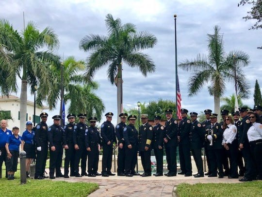 Village of Tequesta Fire Rescue & Police Department in front of the 9-11 Memorial