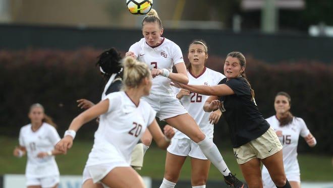 FSU's Megan Connolly heads the ball against Vanderbilt during their game at the Seminole Soccer Complex Thursday, Aug. 16, 2018.