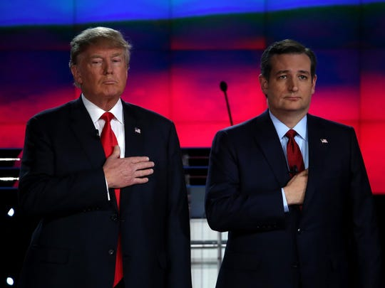 Republican presidential candidates Donald Trump, left, and Sen. Ted Cruz (R-TX) are introduced during the CNN presidential debate at The Venetian Las Vegas on Dec. 15 in Las Vegas, Nevada.