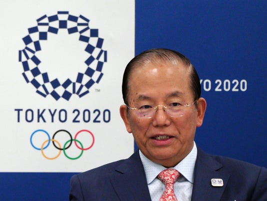Tokyo Organizing Committee CEO of the 2020 Olympics Toshiro Muto attends the Executive Board Meeting of Tokyo Organizing Committee of the Olympics an Paralympic Games (Tokyo 2020) in Tokyo Wednesday, March 28, 2018. A top Tokyo 2020 Olympic official has promised a clean games, pledging to improve water quality in the venue for marathon swimming and triathlon, and to ban four large Japanese construction companies that have been charged with colluding on bids. (AP Photo/Eugene Hoshiko)